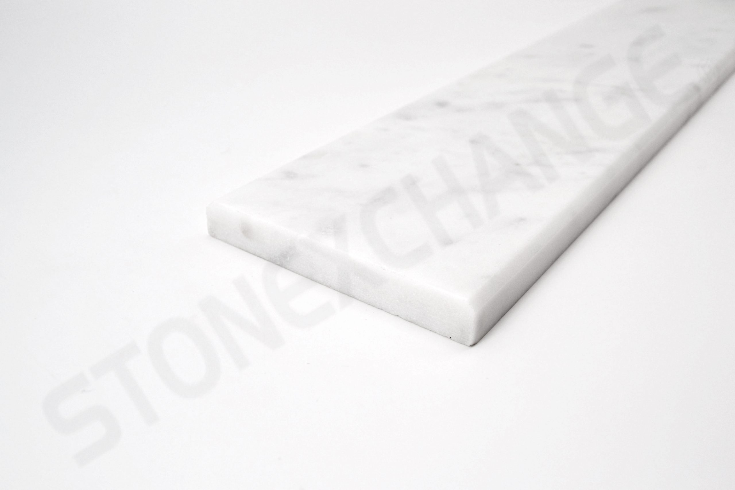 White Carrara Standard Double Bevel Threshold 4x36 Close up
